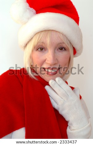 Mrs Santa - Blonde woman wearing Santa hat and red shawl.