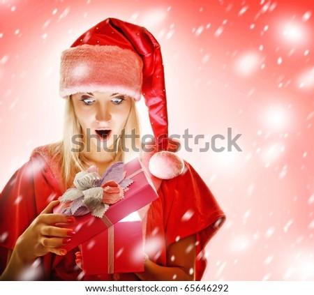 mrs. Santa opening a gift box