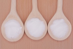 MSM pure powder in 3 wooden spoons.