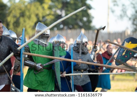 "MSTISLAVL, REPUBLIC OF BELARUS - AUGUST 04-05, 2018: Festival of medieval culture ""Knights Fest. Mstislavl 2018"". Tactical buhurts and mass battles. #1161636979"