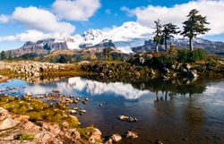 Mt Baker reflected in an icy pond near Park Butte. Mt Baker Snoqualmie National Forest, Cascade Mountains,  Washington.