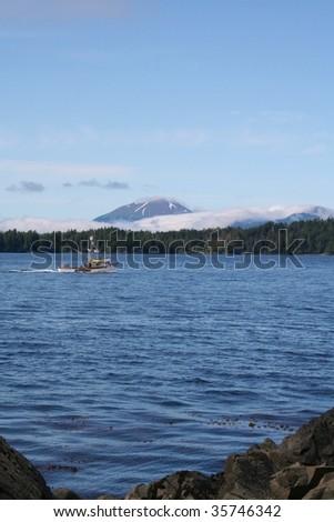 Mt. Edgecumbe volcano near Sitka, Alaska with a fishing boat
