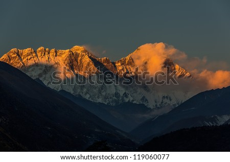Mt. Everest (8848 m) and Lhotse (8511 m) in the last light of the Sun (view from Tengboche monastery) - Nepal, Himalayas