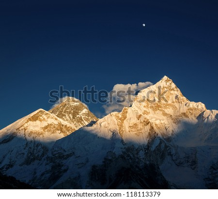 Mt. Everest (8848 m) and Nuptse (7864 m) peaks at sunset (view from Kala Patthar) - Nepal, Himalayas - stock photo