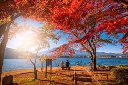 Mt. Fuji over Lake Kawaguchiko with autumn foliage and couple love at sunrise in Fujikawaguchiko, Japan.