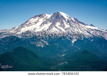 Mt Rainier Volcano -  is the highest mountain of the Cascade Range and the highest mountain in Washington State (USA). It is a large active stratovolcano with an elevation of 14,411ft.