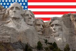 Mt Rushmore National Park in South Dakota with American Flag in the background