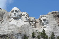 Mt. Rushmore, photographed from the base. Bright sunny day.