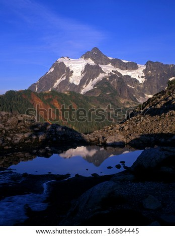 Mt. Shuksan, in North Cascades National Park, reflecting in a small pool, photographed from the Mt. Baker Wilderness Area in Washington State.