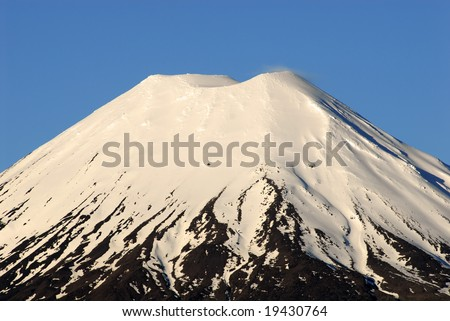 Mt Tongariro - a snow capped volcano in New Zealand's North Island at sunset