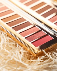 MUA and girly concept. Luxury Eyeshadow palette, eye shadows cosmetics product as luxury beauty brand promotion. Fashion blog design. Contouring palette. Makeup palette close up
