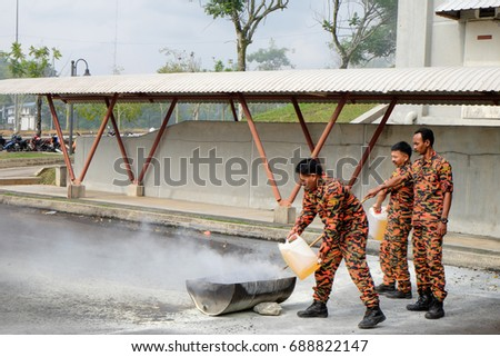 Muadzam Shah, Malaysia August 2nd, 2017: The firefighter are sets on fire a torch flame for training of firemen in Muadzam Shah, Malaysia. #688822147