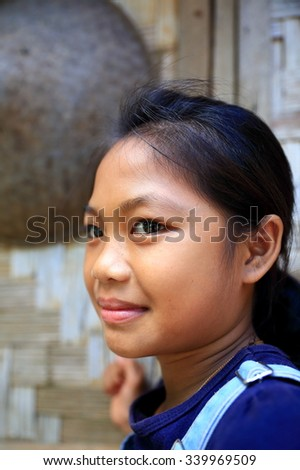 MUANG KHUA,LAOS-OCTOBER 09, 2015:  Students come to receive visits by tourists out of curiosity on October 09, Muang Khua, Laos. #339969509
