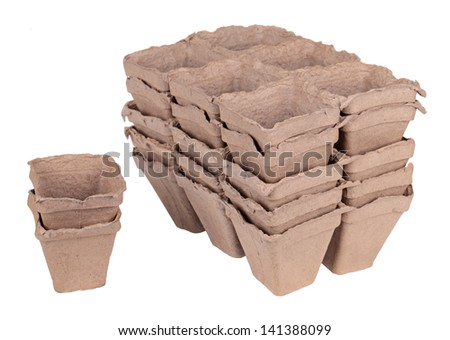 Much peat pots for growing seedlings, isolated on white background