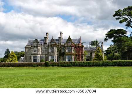 Muckross House, County Kerry, Ireland - is a Tudor style mansion built in 1843 located on the small Muckross Peninsula between two of the lakes of Killarney and is today a popular tourist attraction
