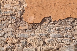 Mud and stone wall texture for background