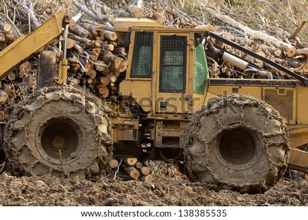 Mud covered heavy duty logging tractor, Stowe, Vermont, USA