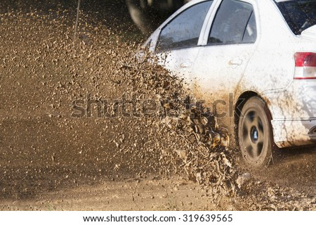 Mud debris splash from a rally car ( Focus at mud debis)