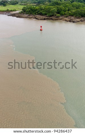 Mud disturbed by ships transiting the Culebra Cut on the Panama Canal