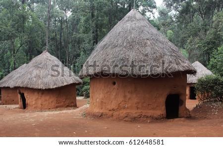 Mud huts in African village - Shutterstock ID 612648581