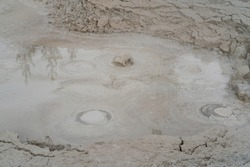 Mud pots in Yellowstone National Park in Wyoming state of the US in America, Unesco World Heritage Site