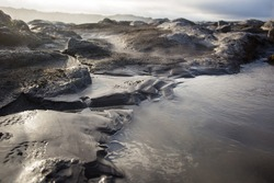 Mud puddle. Sellfoss and Dettifoss waterfalls area, Iceland.