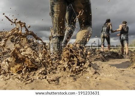 Mud race runner's muddy feet #191233631
