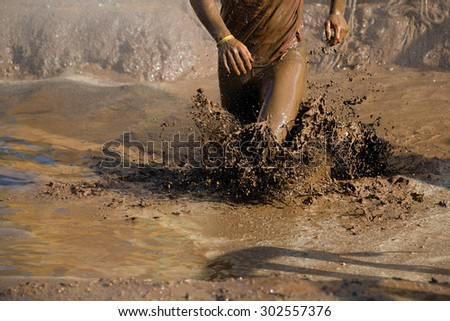 Mud race runners