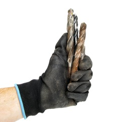 Mudchina shows fist in dirty construction gloves isolated on white background