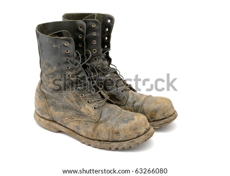 Muddy boots isolated on white background