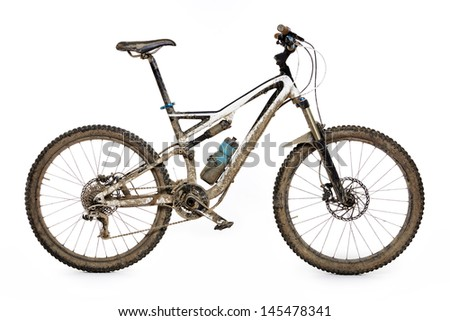 Muddy mountain bike isolated on white background #145478341