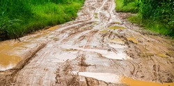 Muddy roads,Dirt road after heavy rain in rural way.