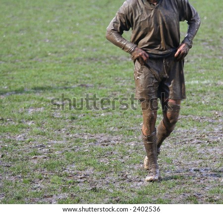 muddy rugby union player