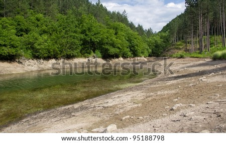 Muddy shores of the lake during the drought