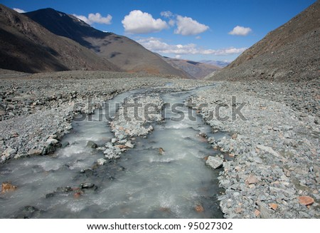 muddy water of a mountain river