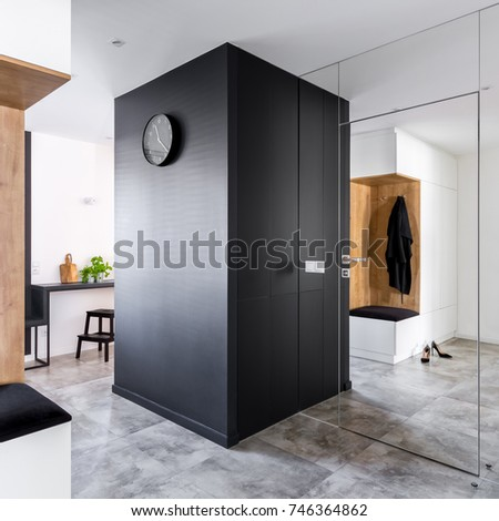 Mudroom with modern mirrored wall open to kitchen #746364862