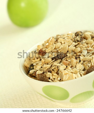 Muesli and green apple - stock photo