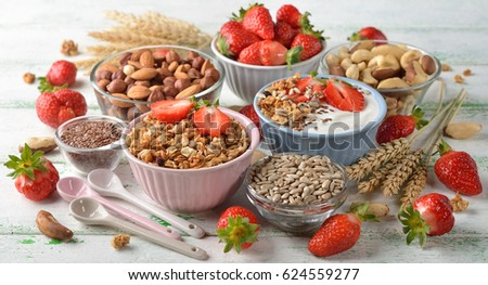 Muesli, nuts, yogurt and cereals, healthy food concept #624559277