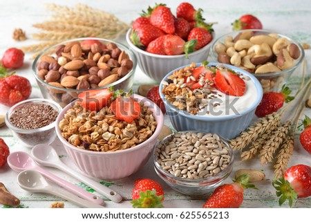 Muesli, nuts, yogurt and cereals, healthy food concept #625565213