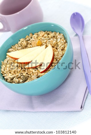 muesli of oats and apple in blue bowl - stock photo