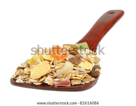 muesli on a wooden spoon isolated on white background