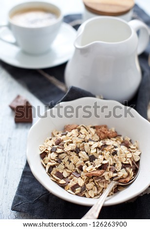 Muesli with chocolate, milk and a cup of coffee