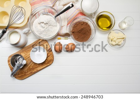 Muffin ingredients: milk, flour, sugar, eggs, butter, olive oil, cocoa powder, baking soda, vanilla extract and vinegar