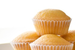 Muffin on a white plate on white background with copy space. Selective focus