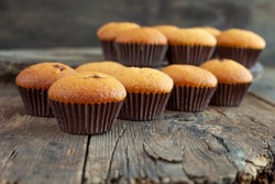 Muffins - homemade portioned cupcakes. Chocolate Muffin - A delicious home-made simple pastry. biscuit dough.