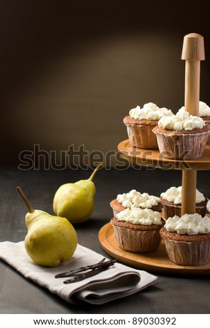 Muffins on a cake stand and peaches and vanilla