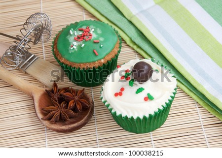 Muffins with baking utensils