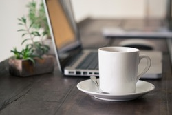 Mug Coffee on wooden work table.