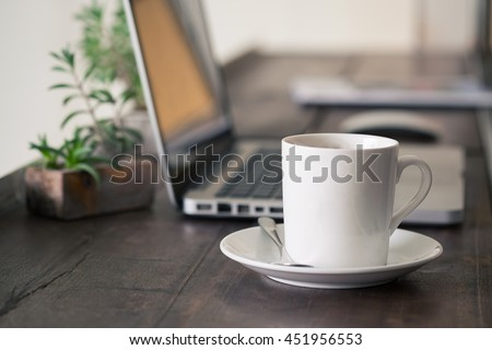 Mug Coffee on wooden work table.