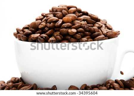 Mug filled with coffee beans